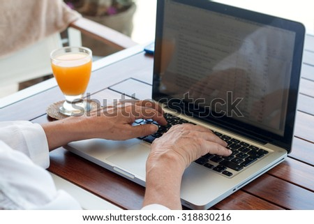Woman's hands keyboarding on laptop computer with blank copy space screen. - stock photo