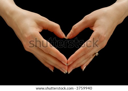 Woman's hands making the shape of a heart - stock photo