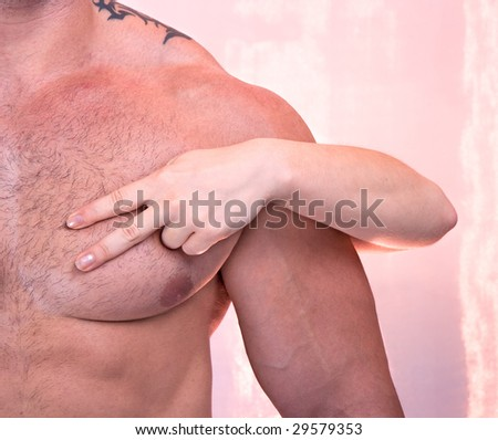 Woman's hands on a sexy man's torso - stock photo