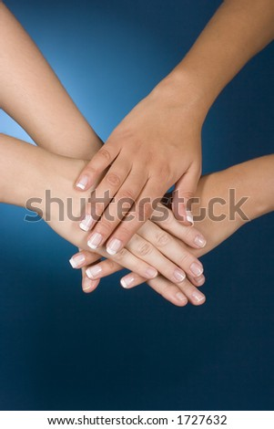 woman's hands show team gesture - stock photo
