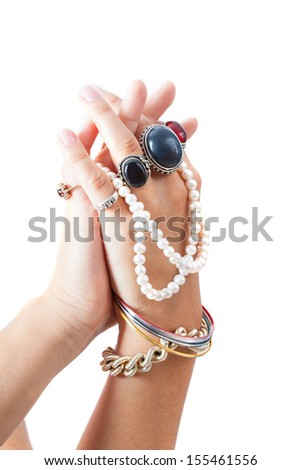 Woman's hands showing jewellery on white isolated background - stock photo