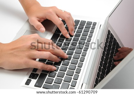 woman's hands typing on laptop - stock photo