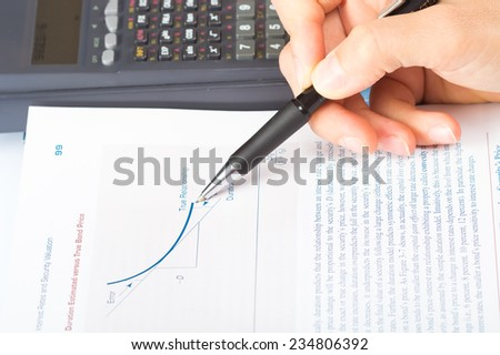 woman's hands with a calculator and a pen, financial statement accounting - stock photo