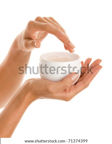 Woman's hands with body lotion - stock photo
