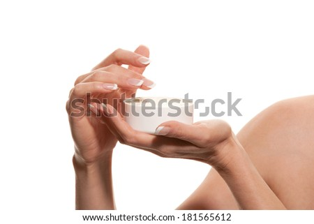 Woman's hands with cosmetic - stock photo