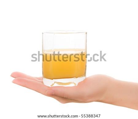 Woman's hands with orange fresh juice - stock photo