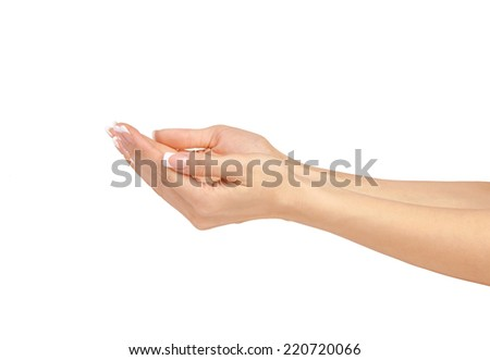 Woman's hands with palm up in a white isolated background