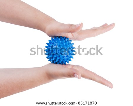 Woman's hands with Spiny plastic blue massage ball isolated on white background