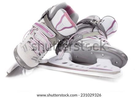Woman's hockey skates on isolated white background - stock photo