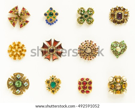 Womanu0027s Jewelry. Old Vintage Brooches. Beautiful Bright Rhinestones Brooches  On White. Not Isolated