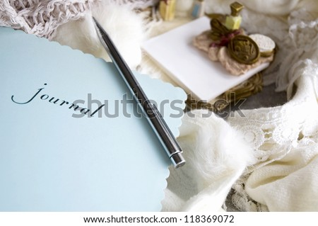 woman's journal book put on wool scarf - stock photo
