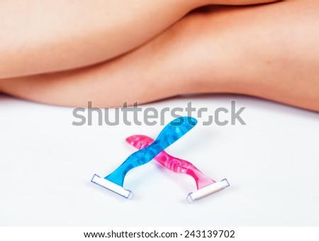 Woman's legs and razors, shaving concept - stock photo