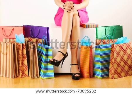 Woman's legs and shopping bags - stock photo