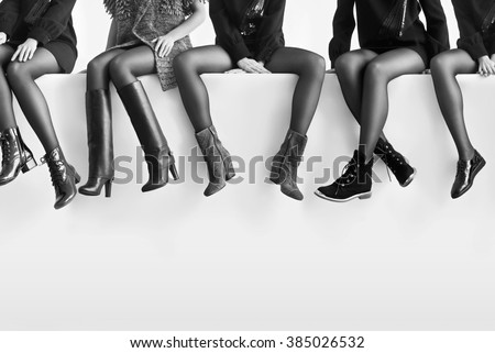 Woman's legs in different shoes - stock photo