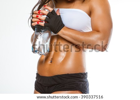Woman's muscular stomach isolated on a white background. - stock photo