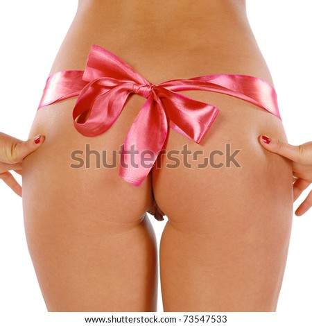 woman's rear with thong and bow detail isolated - stock photo