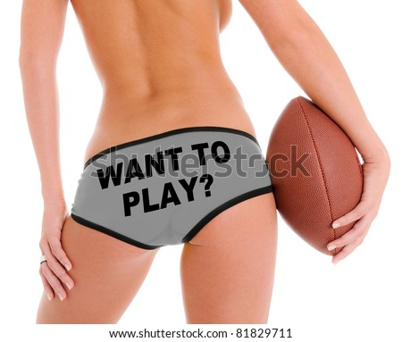 Woman's Sexy Backside Holding a Football and Shorts that reads Want To Play? - stock photo
