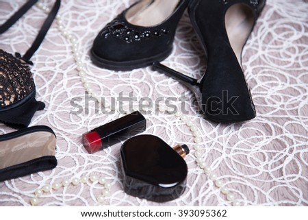 Woman's stuff: underwear, lipstick, shoes, perfume, beads - stock photo
