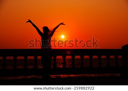 Woman saying 'Thank you' to the nature... - stock photo