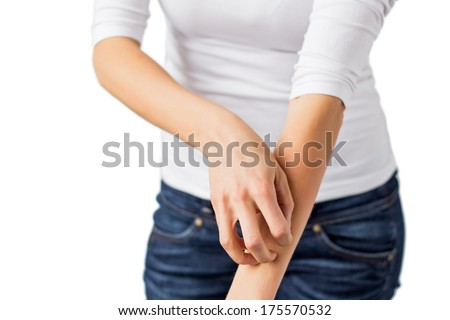 Woman scratching her arm.