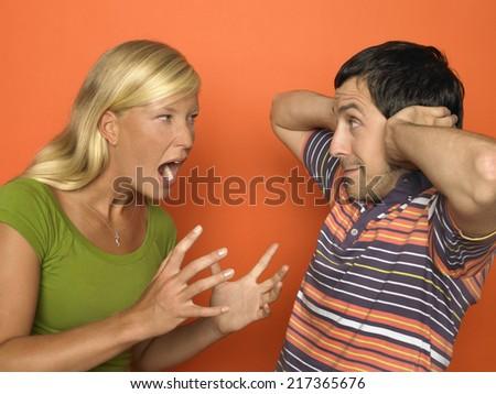Woman screaming at man - stock photo