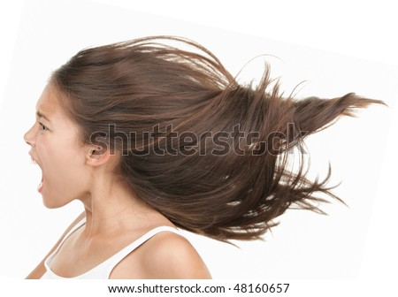 Woman screaming / shouting. Angry and upset beautiful young mixed race asian / caucasian woman in profile. Isolated on white background - stock photo