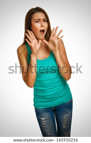 woman screaming wild hair opened her mouth hands to his head emotion background