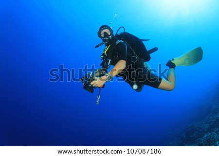Woman Scuba Diver in the Ocean - stock photo