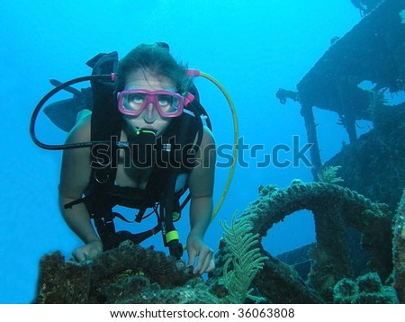 Woman scuba diver on a ship wreck dive site - stock photo