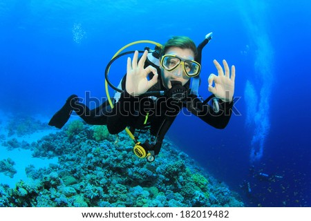 Woman Scuba Diving signals Okay