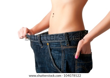 Woman seeing results from her diet - stock photo