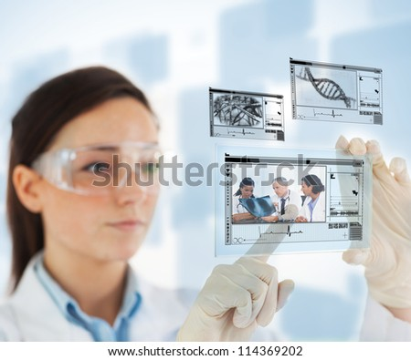 Woman selecting medical images from hologram interface on blue background