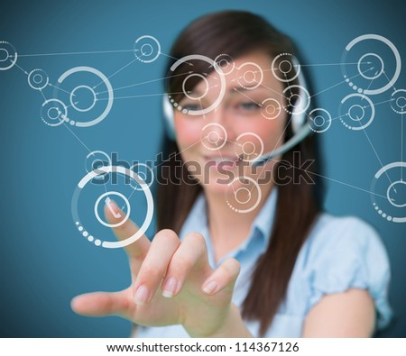 Woman selecting phone symbol from holographic digital interface