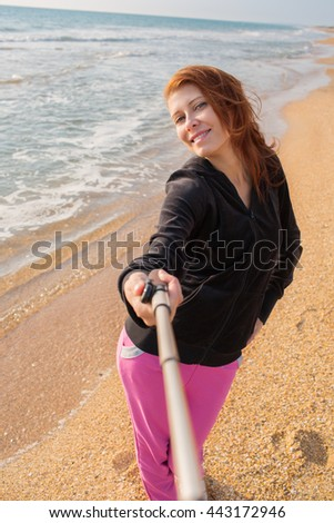 woman selfie with smartphone at sea - stock photo