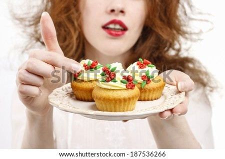 Woman serving cupcakes - stock photo