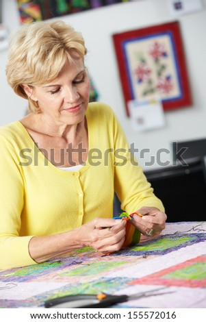 Woman Sewing Quilt - stock photo
