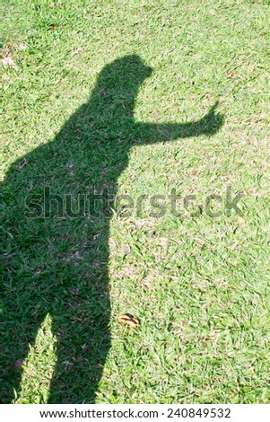 Woman shadow on grasses