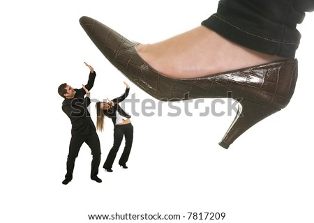woman shoe stepping on business men and woman concept on white - stock photo