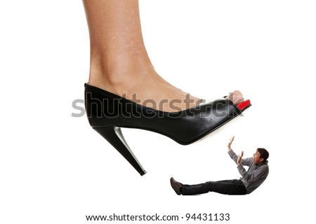 Woman shoe stepping on business men. Concept photo on white background - stock photo