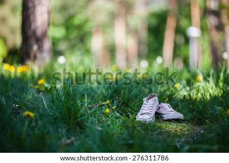 Woman shoes on green grass - stock photo