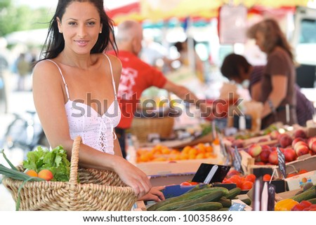 Woman shopping at an outdoor market - stock photo