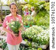 Woman shopping at flower shop green house garden centre - stock photo