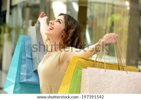 Woman shopping. Beautiful young woman shopping in mall - stock photo