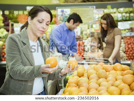 Woman Shopping for Produce at Health Food Store - stock photo