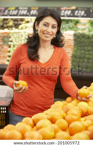 Woman shopping in supermarket - stock photo