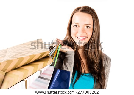 Woman shopping with shopping bags - stock photo