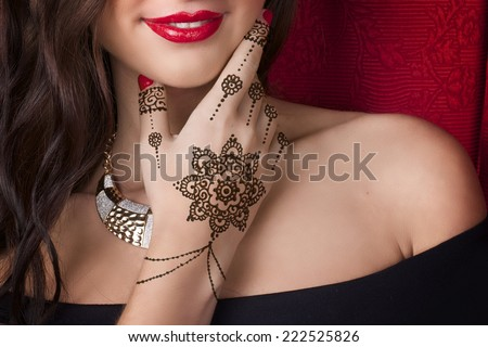 woman shoulder hand with mehendi  - stock photo