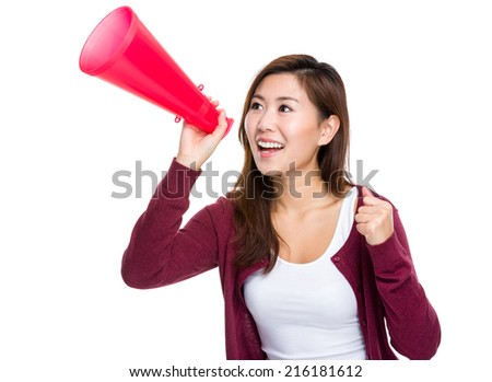 Woman shout with megaphone - stock photo