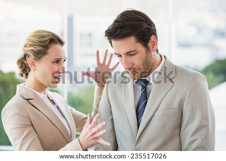 Woman shouting at male colleague in office - stock photo