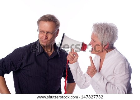 Woman shouting with a megaphone to her husband